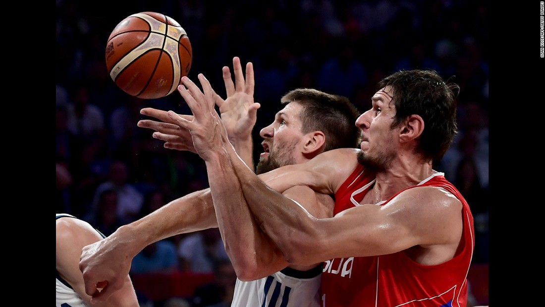 "Slovenian center Gasper Vidmar, center, tussles with Serbian center Boban Marjanovic during <a href=""http://bleacherreport.com/articles/2733702-eurobasket-2017-final-goran-dragics-35-points-power-slovenia-past-serbia"" target=""_blank"">the EuroBasket final</a> on Sunday, September 17. Slovenia won 93-85 behind 35 points from Goran Dragic. Dragic was named the tournament's MVP."