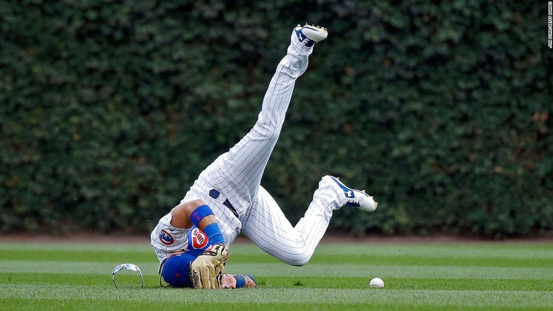 Chicago Cubs outfielder Albert Almora Jr. crashes into the ground as he tries to make a diving catch against St. Louis on Sunday, September 17.