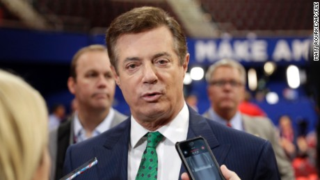 Trump Campaign Chairman Paul Manafort talks to reporters on the floor of the Republican National Convention at Quicken Loans Arena, Sunday, July 17, 2016, in Cleveland. (AP Photo/Matt Rourke)