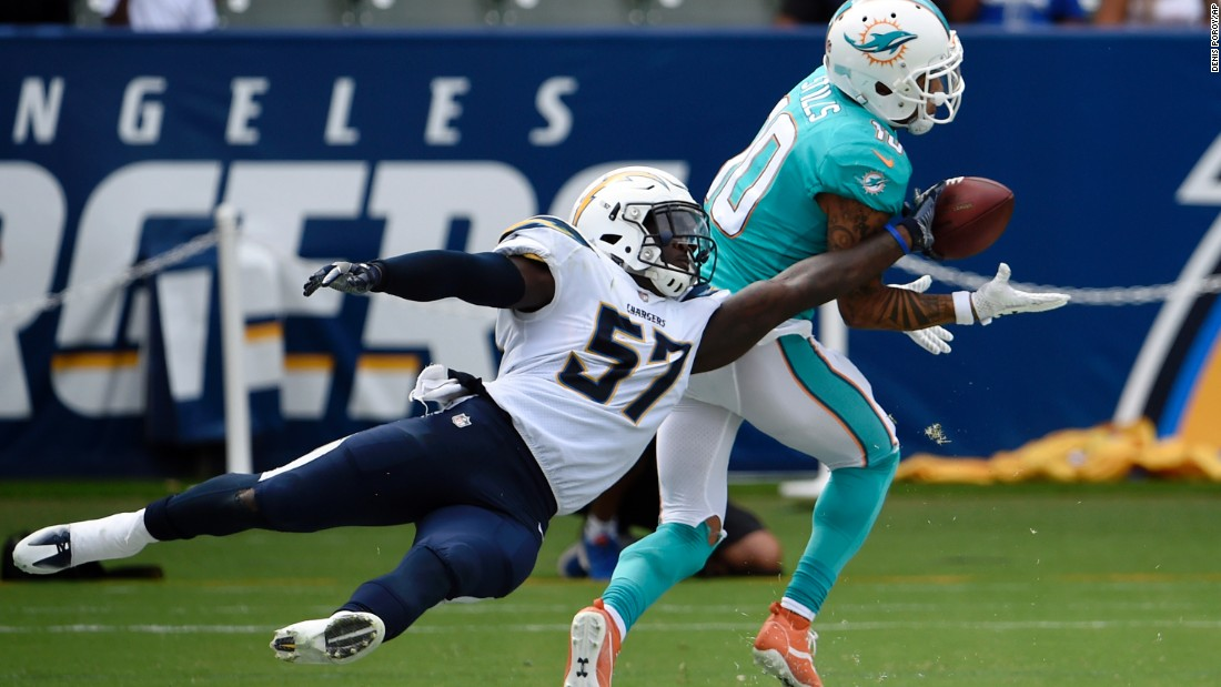 Miami wide receiver Kenny Stills makes a touchdown catch as Los Angeles Chargers linebacker Jatavis Brown tries to get his hand on the ball during the second half of an NFL game on Sunday, September 17.