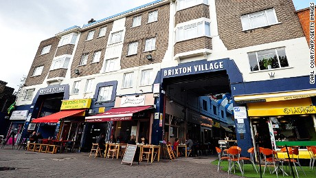 A picture shows Brixton Village market in south London on October 17, 2013. Brixton, the once infamous district, has been transformed by gentrification. Along the roads where hordes of young black men battled police in 1981, wine bars and sushi restaurants have flourished, squats have been cleared and houses are now selling for over ?1 million ($1.6 million, 1.2 million euros). AFP PHOTO / CARL COURT        (Photo credit should read CARL COURT/AFP/Getty Images)