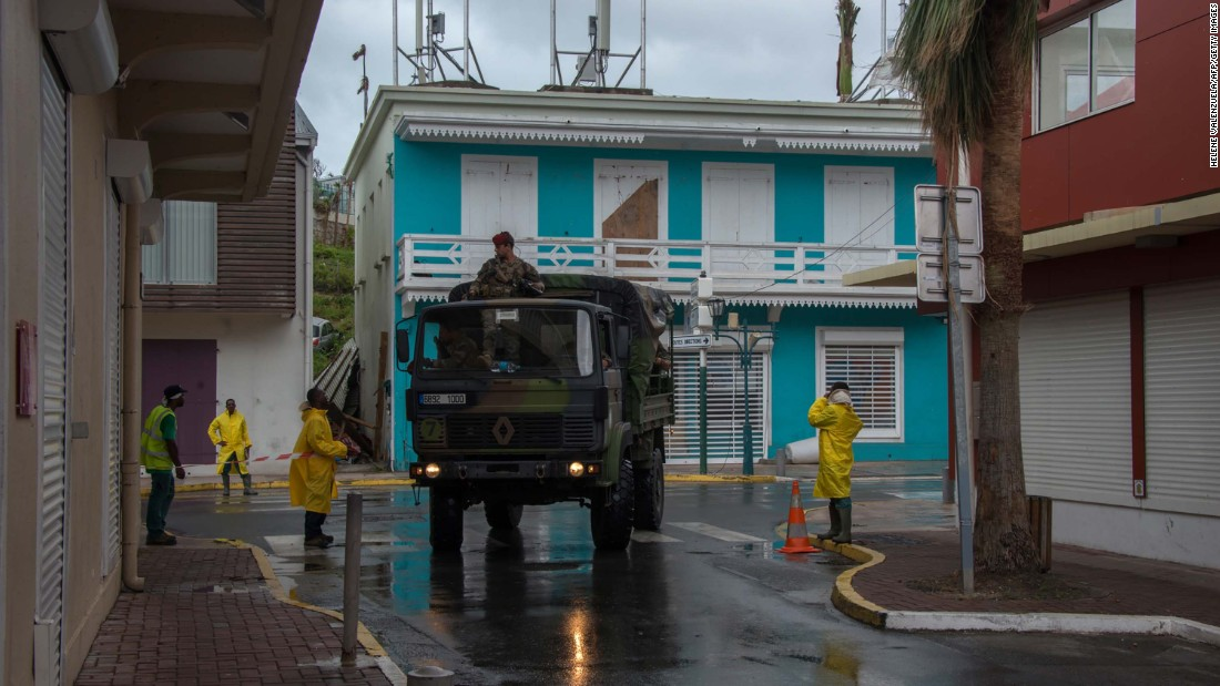 Soldiers patrol a street in Marigot, St. Martin, as preparations were made for Maria on September 19.