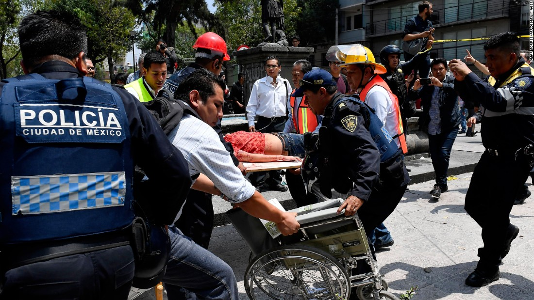 A woman receives medical assistance after she was injured in Mexico City on September 19.