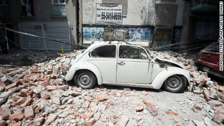 Picture of a car crashed by debris from a damaged building after an earthquake rattled Mexico City on September 19.