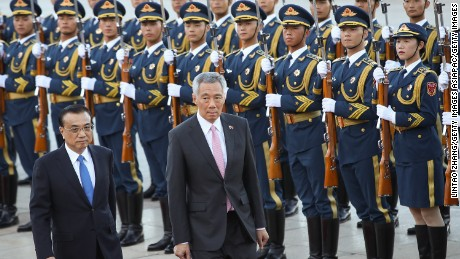 Singapore Prime Minister Lee Hsien Loong views a guard of honor with China's Premier Li Keqiang during a welcoming ceremony outside the Great Hall of the People on September 19, 2017 in Beijing, China.