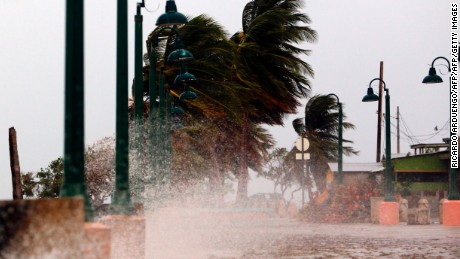 "TOPSHOT - Winds lash the coastal city of Fajardo as Hurricane Maria approaches Puerto Rico, on September 19, 2017.  Maria headed towards the Virgin Islands and Puerto Rico after battering the eastern Caribbean island of Dominica, with the US National Hurricane Center warning of a ""potentially catastrophic"" impact. / AFP PHOTO / Ricardo ARDUENGO        (Photo credit should read RICARDO ARDUENGO/AFP/Getty Images)"