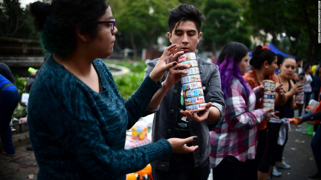Volunteers arrange food and other donated supplies at a distribution point in Mexico City on September 20.