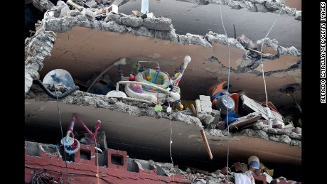 Children's toys are seen in a building flattened by the quake in Mexico City on September 20.
