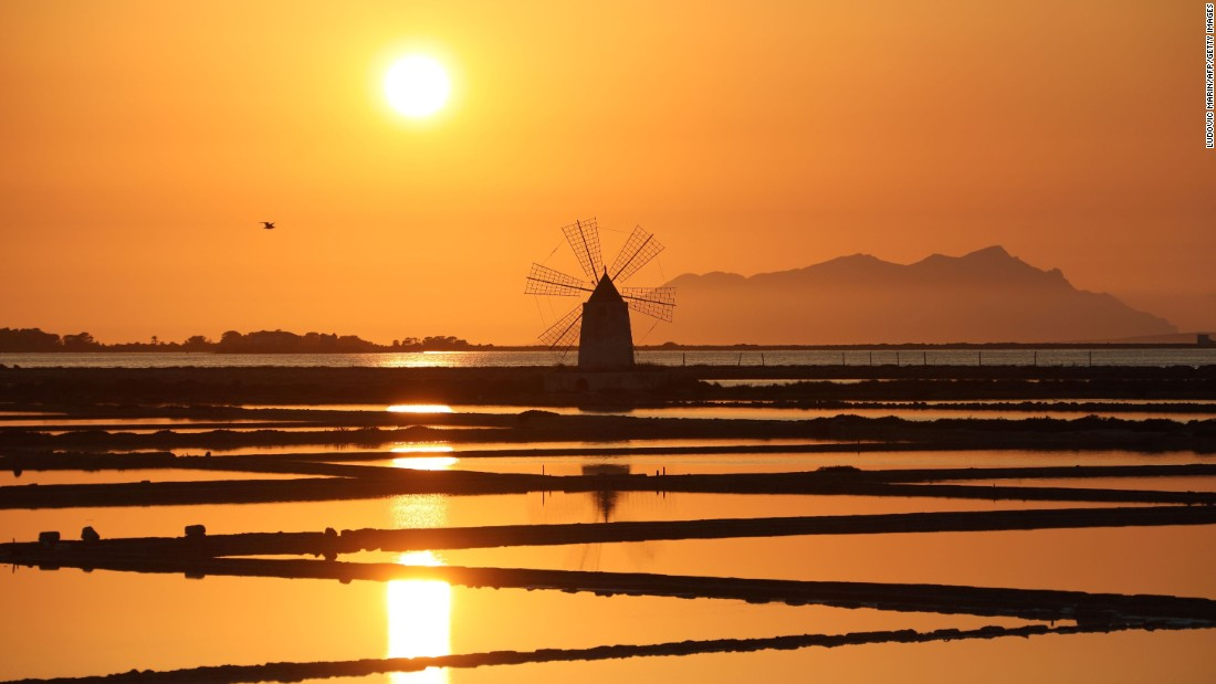 <strong>Marsala, Italy: </strong>The sun sets over a windmill in the Sicilian coastal town of Marsala, famous for its wine. <br />