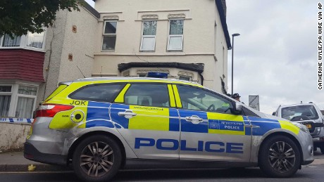 Police are seen outside a property in Thornton Heath, south London, after a teenager was arrested by detectives investigating the Parsons Green terror attack.