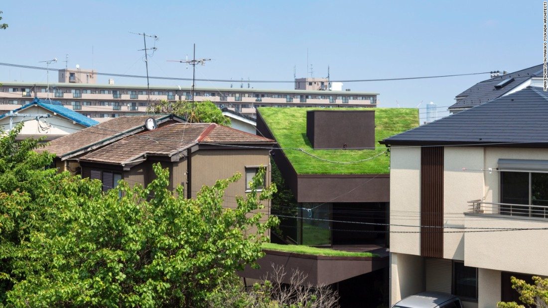 "The Grass Cave House by Tokyo-based Makiko Tsukada Architects is a wooden structure, featuring ""hat-like"" roofs that absorb solar radiation in summer, and function as insulation in the winter."