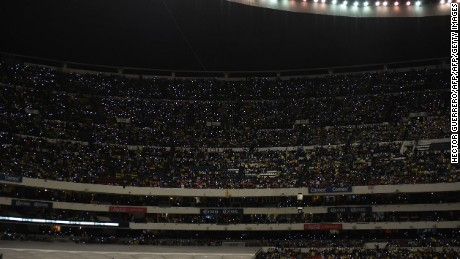 Fans shine lights during the one-minute of silence in memory of the footballers of the team Chapecoense of Brazil, killed tragically in a plane crash in Colombia, before the start of the second leg of semifinal of Mexican Apertura 2016 tournament football match America against Necaxa at the Azteca stadium in Mexico City, Mexico, December 4, 2016. / AFP / Hector GUERRERO        (Photo credit should read HECTOR GUERRERO/AFP/Getty Images)