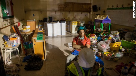 Emergency rescue workers rest inside the school complex late Wednesday night.