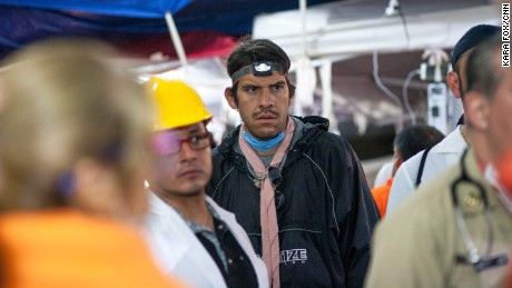 Inside the medical tent on the school site, volunteer doctors are briefed on the progress of the rescue effort.