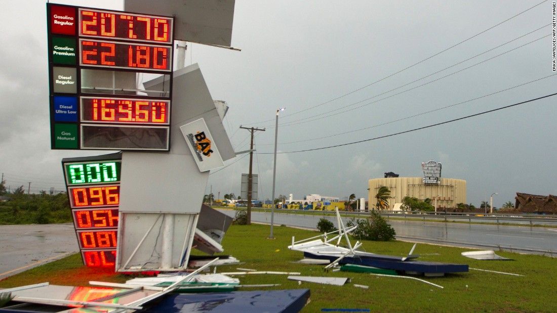 A gas station's sign is damaged in Punta Cana, Dominican Republic, as the hurricane passed just north of the country on September 21.