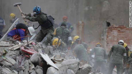 Rescue workers search for survivors at an apartment building located on the street corner of Amsterdam and Laredo, that collapsed during an earthquake in the Condesa neighborhood of Mexico City, Thursday, Sept. 21, 2017. Tuesday's magnitude 7.1 earthquake has stunned central Mexico, killing more than 200 people as buildings collapsed in plumes of dust. (AP Photo/Natacha Pisarenko)