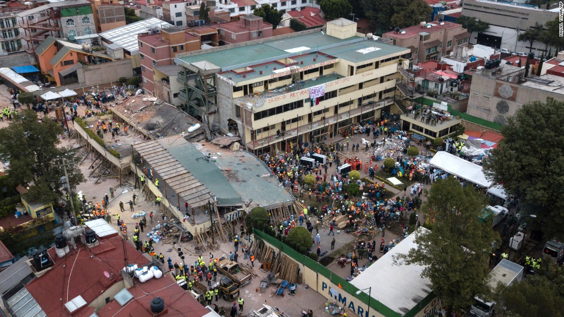 "Volunteers and rescue workers search for people<a href=""http://www.cnn.com/2017/09/20/world/enrique-rebsamen-school-mexico-earthquake-trnd/index.html"" target=""_blank""> trapped inside a Mexico City elementary school</a> on Wednesday, September 20. The school collapsed in an earthquake the day before."