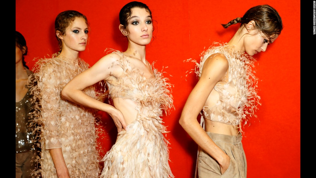 Models are seen backstage at an Alberta Ferretti show in Milan, Italy, on Wednesday, September 20.