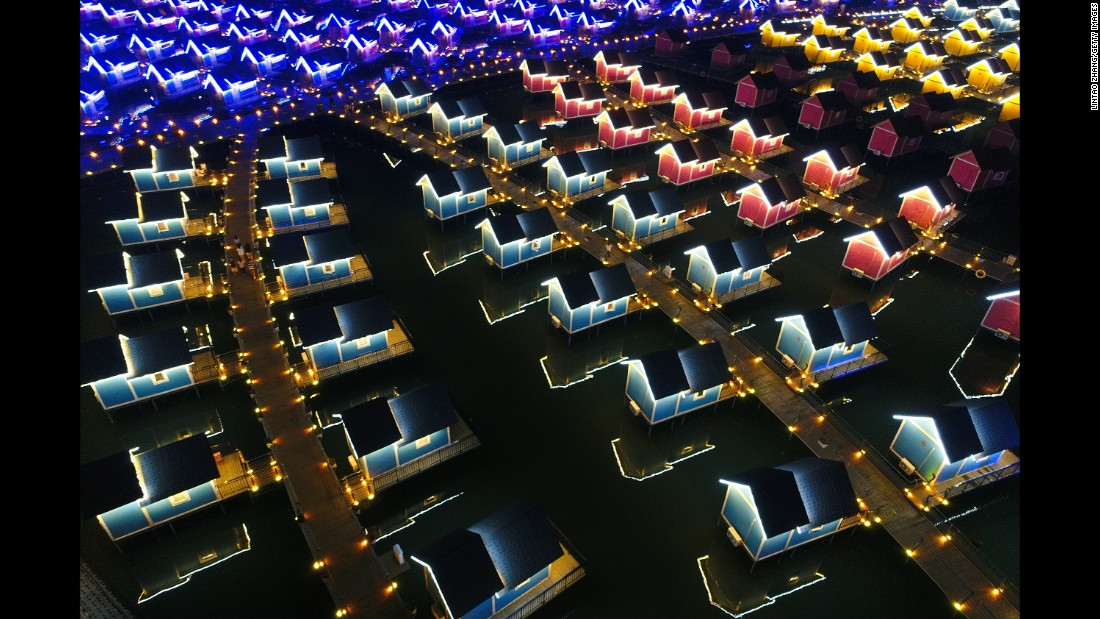 Cabins are lit up on the Yue Tuo Island Resort in Tangshan, China, on Monday, September 18.