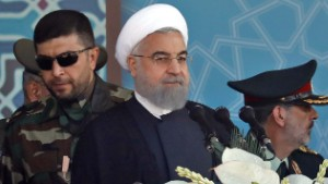 Iranian President Hassan Rouhani sits among senior army staff as he delivers his speech during the annual military parade marking the anniversary of the outbreak of its devastating 1980-1988 war with Saddam Hussein's Iraq, on September 22, 2017 in Tehran. Rouhani vowed that Iran would boost its ballistic missile capabilities despite criticism from the United States and also France. / AFP PHOTO / str (Photo credit should read STR/AFP/Getty Images)