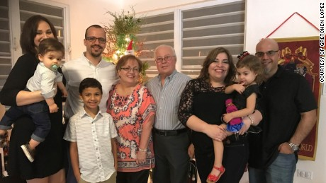 Gretchen Lopez' family in Puerto Rico. From left to right: sister-in-law Cristine Arana (Joaquin Flores, nephew in her arms), brother Ruben Flores Agrait (his son Esteban Flores in front of him), mom Wilma Agrait, dad Ruben Flores, Gretchen Lopez, husband and daughter Alana.
