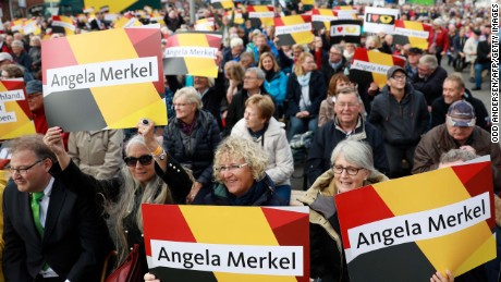 Supporters hold signs with the name of German Chancellor Angela Merkel before she addresses an election campaign rally of the Christian Democratic Union (CDU) in Kappeln, northern Germany on September 20, 2017, during the final days before Germans head to the polls. / AFP PHOTO / Odd ANDERSEN        (Photo credit should read ODD ANDERSEN/AFP/Getty Images)