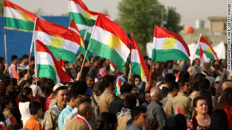 Iranian Kurds hold Kurdish flags as they take part in a gathering to urge people to vote in the upcoming independence referendum in the town of Bahirka, north of Arbil, the capital of the autonomous Kurdish region of northern Iraq, on September 21, 2017. The controversial referendum on independence for Iraqi Kurdistan is set for September 25. / AFP PHOTO / SAFIN HAMED        (Photo credit should read SAFIN HAMED/AFP/Getty Images)