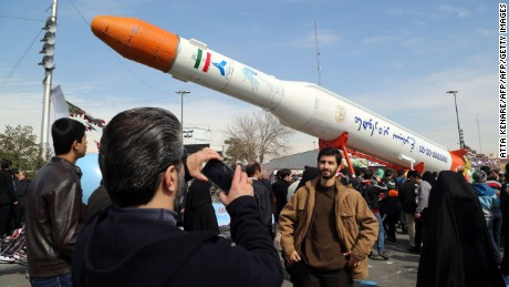 "Iranians take pictures of the Simorgh (Phoenix) satellite rocket during celebrations in Tehran to mark the 37th anniversary of the Islamic revolution on February 11, 2016.    Iranians waved ""Death to America"" banners and took selfies with a ballistic missile as they marked 37 years since the Islamic revolution, weeks after Iran finalised a nuclear deal with world powers.  / AFP / ATTA KENARE        (Photo credit should read ATTA KENARE/AFP/Getty Images)"