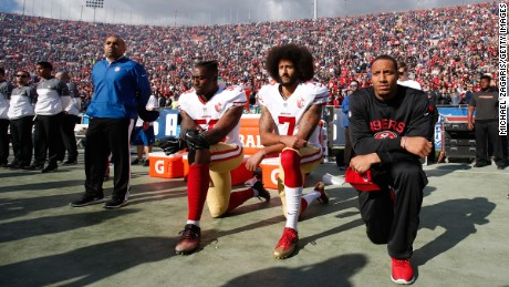 LOS ANGELES, CA - DECEMBER, 24: Eli Harold #58, Colin Kaepernick #7 and Eric Reid #35 of the San Francisco 49ers kneel on the sideline, during the anthem, prior to the game against the Los Angeles Rams at the Los Angeles Coliseum on December 24, 2016 in Los Angeles, California. The 49ers defeated the Rams 22-21. (Photo by Michael Zagaris/San Francisco 49ers/Getty Images)