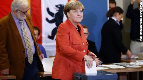 Merkel gets fourth term but German voters deliver far-right surge