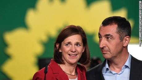 Katrin Göring-Eckardt (L) and Cem Özdemir of the Green party speak to supporters after exit poll results were announced on Sunday.