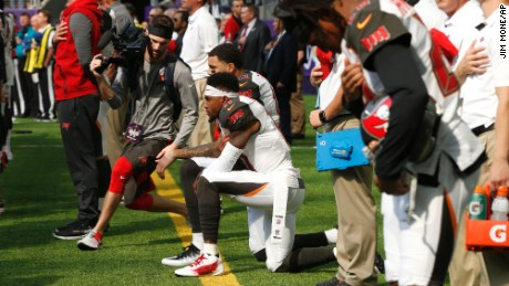 Wide receivers DeSean Jackson, forefront, and Mike Evans take a knee before Sunday's game.