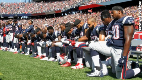 Members of the New England Patriots kneel during the National Anthem before a game against the Houston Texans at Gillette Stadium on September 24, 2017 in Foxboro, Massachusetts.
