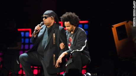 "Stevie Wonder, left, takes a knee ""for the country"" with his son, Kwame Morris, before performing at the 2017 Global Citizen Festival in Central Park, Saturday, Sept. 23, 2017, in New York. The festival aims to end extreme poverty through the collective actions of Global Citizens by 2030.  (AP Photo/Michael Noble Jr.)"