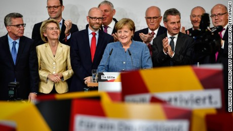 BERLIN, GERMANY - SEPTEMBER 24: German Chancellor and Christian Democrat (CDU) Angela Merkel (C) reacts to initial results that give the party 32,9% of the vote, giving it a first place finish, in German federal elections on September 24, 2017 in Berlin, Germany. Chancellor Merkel is seeking a fourth term and coming weeks will likely be dominated by negotiations between parties over the next coalition government. (Photo by Alexander Koerner/Getty Images)