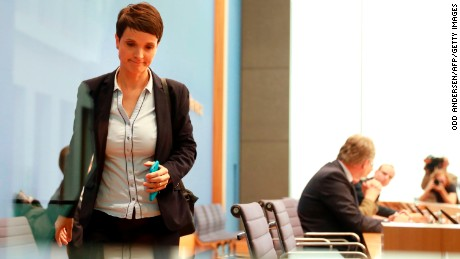 Frauke Petry walks out of the AfD press conference Monday.