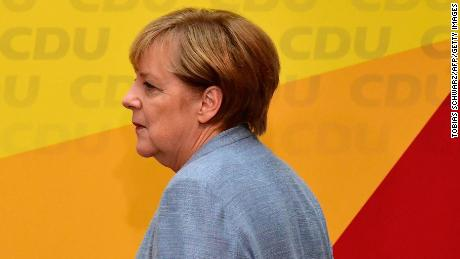 German Chancellor Angela Merkel arrives to give a press conference at the headquarters of the Christian Democratic Union (CDU) party in Berlin on September 25, 2017, one day after general elections.