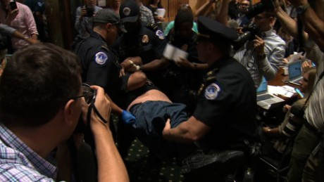 Protesters disrupt health care bill hearing