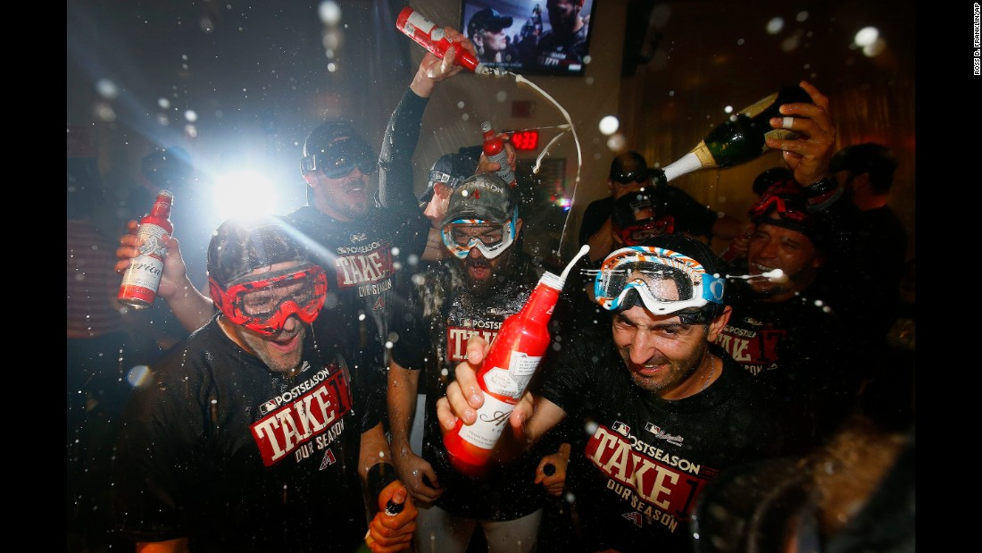 The Arizona Diamondbacks celebrate in the locker room Sunday, September 24, after a 3-2 victory over Miami clinched a spot in the playoffs. They will host the National League Wild Card game on October 4.