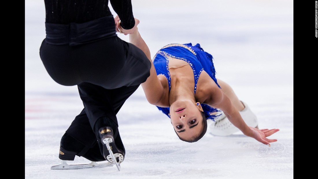 Canadian figure skater Chloe Panetta is held by her partner, Steven Lapointe, during a Junior Grand Prix event in Minsk, Belarus, on Friday, September 22.