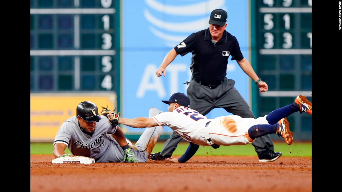 Jose Abreu, first baseman for the Chicago White Sox, avoids a tag from Houston's Jose Altuve on Thursday, September 21.
