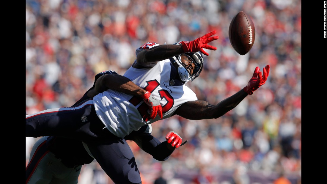 Houston wide receiver Bruce Ellington pulls in a pass during an NFL game at New England on Sunday, September 24.