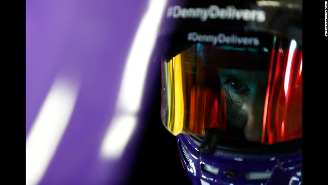 NASCAR driver Denny Hamlin sits in his car during practice in Loudon, New Hampshire, on Saturday, September 23.