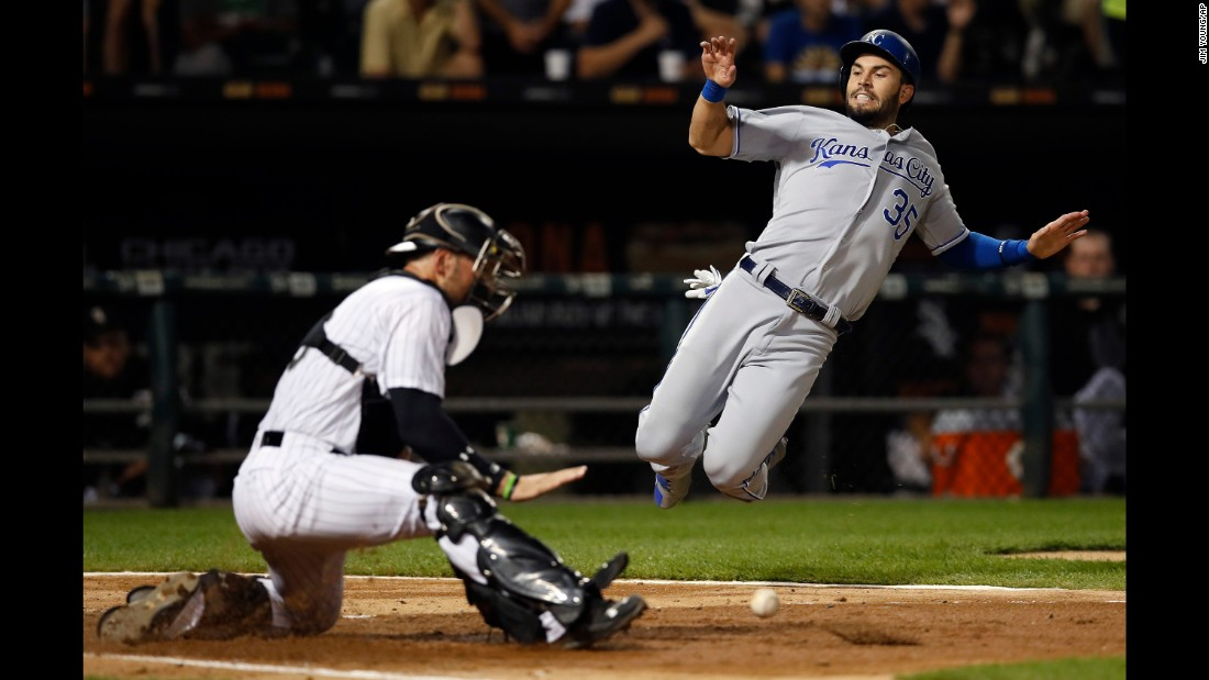 Kansas City's Eric Hosmer slides safely into home plate during a game in Chicago on Saturday, September 23.