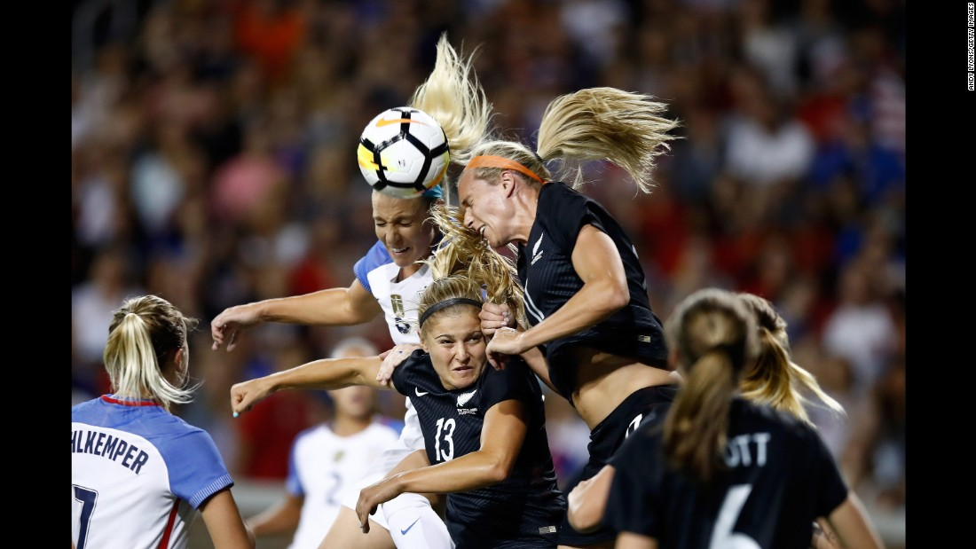 New Zealand's Kirsty Yallop, top right, goes for a header next to the United States' Julie Ertz during an international friendly on Tuesday, September 19. The United States won 5-0 in Cincinnati.