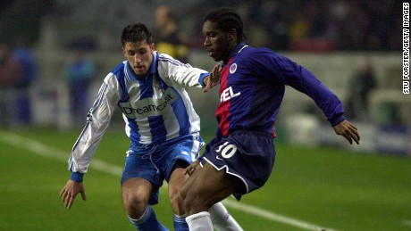 21 Nov 2000:  Augustine Okocha of Paris is watched by a Deportivo La Coruna defender during the Champions League Group B match between Paris St Germain v Deportivo La Coruna at Parc des Princes, Paris, France. Mandatory Credit: Stu Forster/ALLSPORT