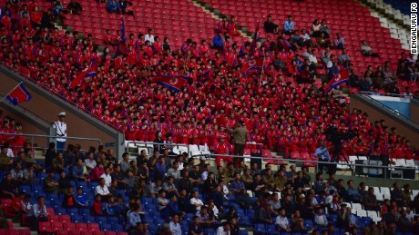 April 25 fans watch their team dressed in North Korean colors.