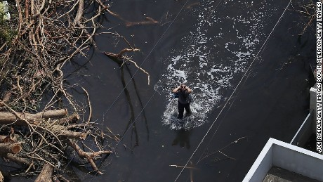 SAN JUAN, PUERTO RICO - SEPTEMBER 25:  A flooded street is seen as people deal with the aftermath of Hurricane Maria on September 25, 2017 in San Juan Puerto Rico. Maria left widespread damage across Puerto Rico, with virtually the whole island without power or cell service.  (Photo by Joe Raedle/Getty Images)