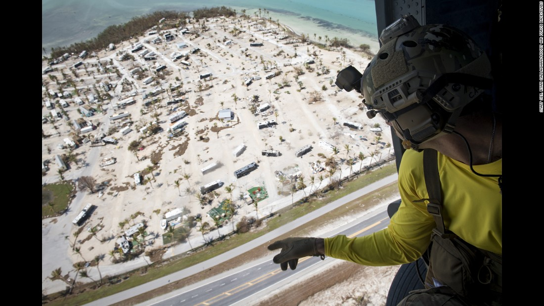 "A pararescueman from the US Air Force's 48th Rescue Squadron scans the ground Tuesday, September 12, after Hurricane Irma hit the Florida Keys. The storm <a href=""http://www.cnn.com/interactive/2017/09/us/hurricane-irma-florida-photos/"" target=""_blank"">caused historic destruction</a> across the state."