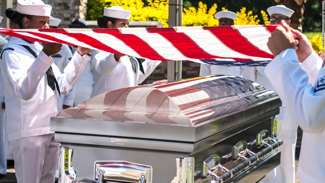 Sailors drape a flag over the casket of Petty Officer 1st Class Charles Casto during a repatriation ceremony in Honolulu on Thursday, September 14. Casto was aboard the USS Oklahoma during the attack on Pearl Harbor, and his remains were recently identified. He was buried alongside his brother, Richard, who was also aboard the Oklahoma.